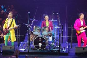 ON STAGE: Beyond band members (from left) Wong Ka Keung, Yip Sai Wing and Paul Wong before they disbanded in 2005.