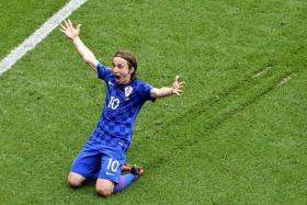 TRAIL BLAZER:Croatia's Luka Modric sliding on the pitch in celebration after scoring the superb volley off a half-cleared ball.