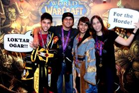 TEAMWORK: (From left) Jason, Mr Austin Lay, Trisha and Mrs Tanja Lay at the World Of Warcraft 10th anniversary event at Zouk in December 2014.
