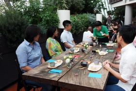 SOCIAL INITIATIVE: (Above) An ongoing session at Hush TeaBar.