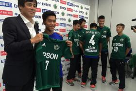 STAR TREATMENT: Matsumoto Yamaga youth academy director Takeshi Yamazaki (far left) presenting personalised jerseys to the six National Football Academy players.