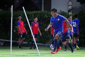 OLD HEAD: Garena Young Lions striker Khairul Amri (above, in the foreground) is one of three senior players in the developmental team and uses his vast experience to guide his teammates.