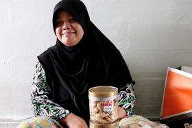 GRATEFUL: Madam Rohaya Zainal Abidin above) received donations of groceries and money after her story was reported in The New Paper yesterday.