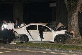 HORRIFYING: (Above) The car crashed into a tree at about 1am yesterday at Lentor Avenue.