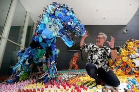 WORKS OF ART: Japanese artist Hiroshi Fuji created four dinosaur statues from old toys.
