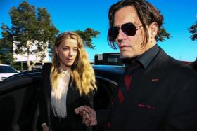 IT'S OVER: Amber Heard and Johnny Depp were married for 15 months.