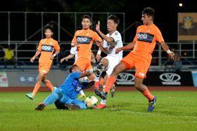 RUN ENDS: Albirex Niigata (in white) broke Hougang's (in orange) six-game unbeaten streak at home last night.