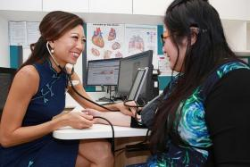 EXPERIENCED: Associate Professor Carolyn Lam, principal investigator of the study and senior consultant with the Department of Cardiology at the National Heart Centre, assessing a patient.