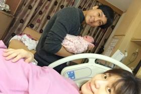 Relieved: Andie Chen and Kate Pang with their newborn daughter Avery. She weighs 3.65kg.