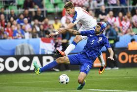 Czech Republic forward Milan Skoda (in white) challenges Croatia's Vedran Corluka for the ball during their Euro 2016 clash.