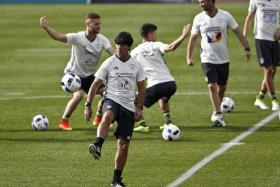 FORWARD LOOKING: Germany coach Joachim Loew believes his side will top their group and play their Round of 16 match in Lille, where they could face one of the four best third-placed sides.