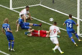 Iceland's Birkir Saevarsson scores an own goal and Hungary's first