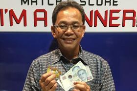 ALL SMILES: Mr Wari Ismail (above) and Mr Loke Kok Kean won $100 each yesterday.
