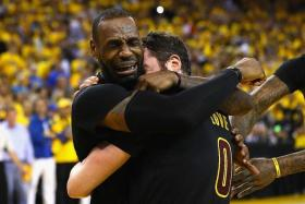 LOVE AND TEARS: Lebron James (left) and Kevin Love crying with joy after winning the NBA title.