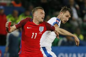 England's Jamie Vardy (left) in action with Slovakia's Norbert Gyomber