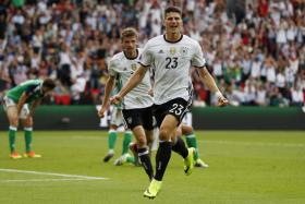 Mario Gomez celebrates after scoring Germany's winner against Northern Ireland.