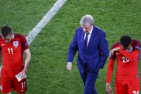 HOPELESS: Jamie Vardy (left) fails to fire in Roy Hodgson's (right) disjointed line-up.