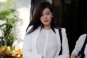 CHARGED: Actress Rui En leaving court yesterday.