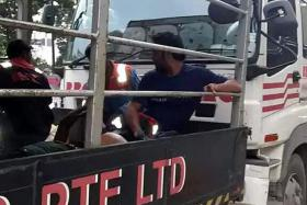 CRASH: One of the lorries was carrying workers from their dormitory in Soon Lee Road to their Tanah Merah worksite when the collision occurred. It also damaged the windscreen of the lorry.