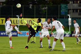 4 Tampines' Fazrul Nawaz (kicking ball) continues his record of scoring in all of Akbar Nawas' four games in charge.