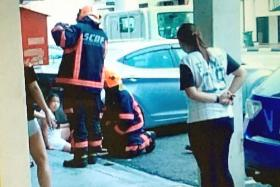 FREED: The 11-year-old girl was rescued by the Singapore Civil Defence Force.