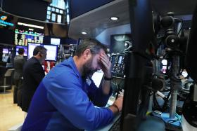 SHOCK: Traders in New York after the vote was announced.