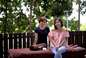 The co-founder of The Outcall Spa, Ms Stella Tan (right), and one of the massage therapists, Flora.