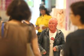 Ms Ng Poh Peng  was born with ichthyosis, a rare skin condition that causes her skin to peel excessively.