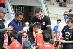 WELL DONE: (From far left) ActiveSG coach Robin Chitrakar, national coach V Sundramoorthy and ActiveSG academy principal Aleksandar Duric giving out medals to participants yesterday.