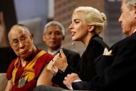 "The Dalai Lama and singer Lady Gaga appear together for a question and answer session on ""the global significance of building compassionate cities"" at the U.S. Conference of Mayors 84th Annual Meeting in Indianapolis, Indiana United States, June 26, 2016."