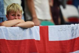 A young England fan reacts during after England lost 1-2 to Iceland in the Euro 2016.