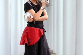 ON HER OWN: (Above) Miss Adeline Ng is, to her knowledge, the only solo professional female magician here.