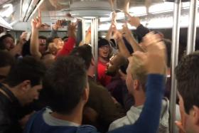England and Spain fans unite to sing on a Paris Metro train after their teams were eliminated from Euro 2016.