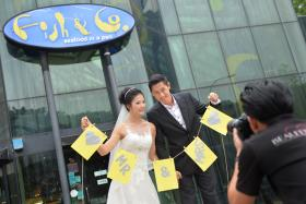 Mr Jonathan Ng and Ms C C Ouyang had one of their first few dates at Fish & Co's Glass House and he also proposed to her there.