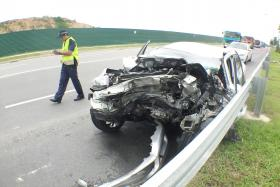 MANGLED: The damaged front part of the car after the accident along Changi Coast Road.