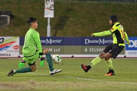 IN-FORM FAZRUL: Tampines Rovers' Fazrul Nawaz (right) restoring their lead by slotting past Global FC's goalkeeper Patrick Deyto.