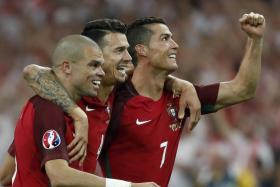 Pepe, Jose Fonte and Cristiano Ronaldo celebrate after winning the penalty shootout