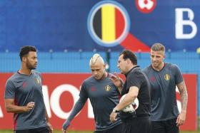 SUPERIOR PERSONNEL: Belgium coach Marc Wilmots (holding ball) has the advantage of having stars like (from left) Mousa Dembele, Radja Nainggolan and Toby Alderweireld.
