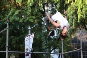 UPSIDE DOWN: (Above) A parkour enthusiast showing what he can do.
