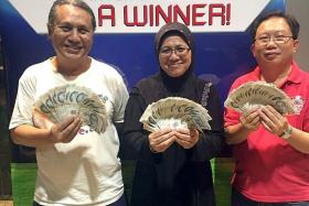 JACKPOT WINNERS: (From left) Mr Mohammad Yunus Karim, Madam Sarifah Abdullah and Mr Ong Hwee Hong.