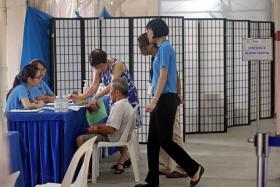 SCREENED: Residents at Blk 203 Ang Mo Kio Ave 3 undergoing the tuberculosis screening