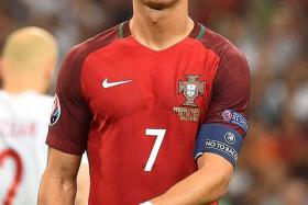 ROLLING-EYES RONALDO: Cristiano Ronaldo (above) has often been a picture of frustration at Euro 2016, unlike his Real Madrid counterpart Gareth Bale.