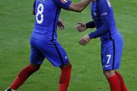 Antoine Griezmann (right, scoring France's fourth goal).