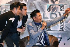 SHUTTERBUG: Chow Yun Fat, who can be seen in the new movie Cold War 2 (left), showed off his selfie skills at a movie press conference here, snapping selfies and wefies with the media.