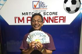 LUCKY SCORE: Mr Wari Ismail, a taxi driver, has won cash prizes in the TNP Match & Score contest on four separate occasions, winning a total of $2,500.