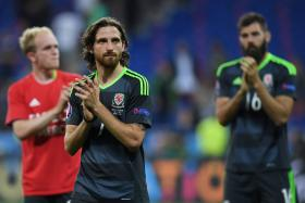 Wales' midfielder Joe Allen reacts at the end of the Euro 2016 semi-final football match between Portugal and Wales at the Parc Olympique Lyonnais stadium in Décines-Charpieu, near Lyon, on July 6, 2016.