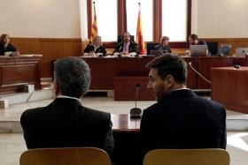 IN THE DOCK: Barcelona star Lionel Messi (above, right) and his father Jorge Horacio (above, left) face judges at a Catalan court in a tax fraud case.