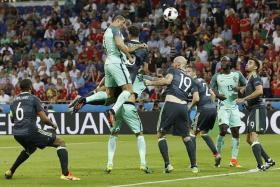 GREAT LEAP: Cristiano Ronaldo rising the highest to head home Portugal's opener.