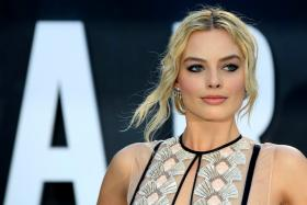 Australian actress Margot Robbie poses at the European premiere of the film The Legend Of Tarzan at Leicester Square in London, England, July 5, 2016.