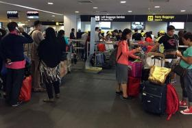 NOT AFRAID: Singapore Cruise Centre was crowded with travellers heading to Batam despite terror threats.
